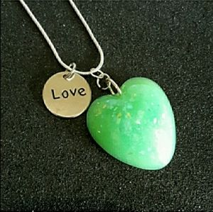 Heart shaped green faux opal on silver necklace